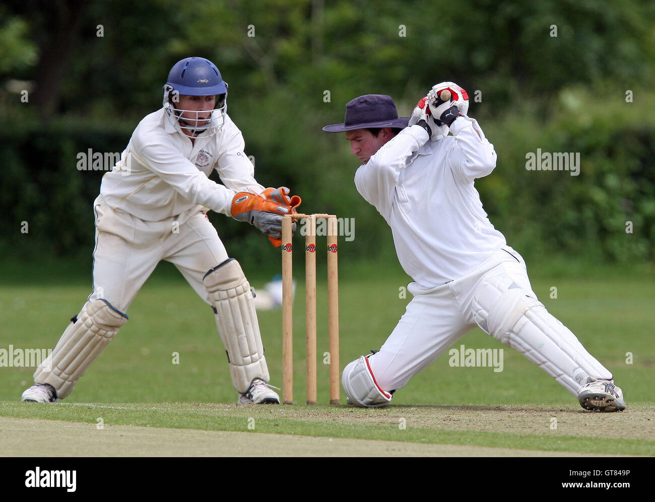 C Swainland behind the stumps as Chingford batsman J Hill looks to hit out - Gidea Park & Romford CC vs Chingford - Stock Image