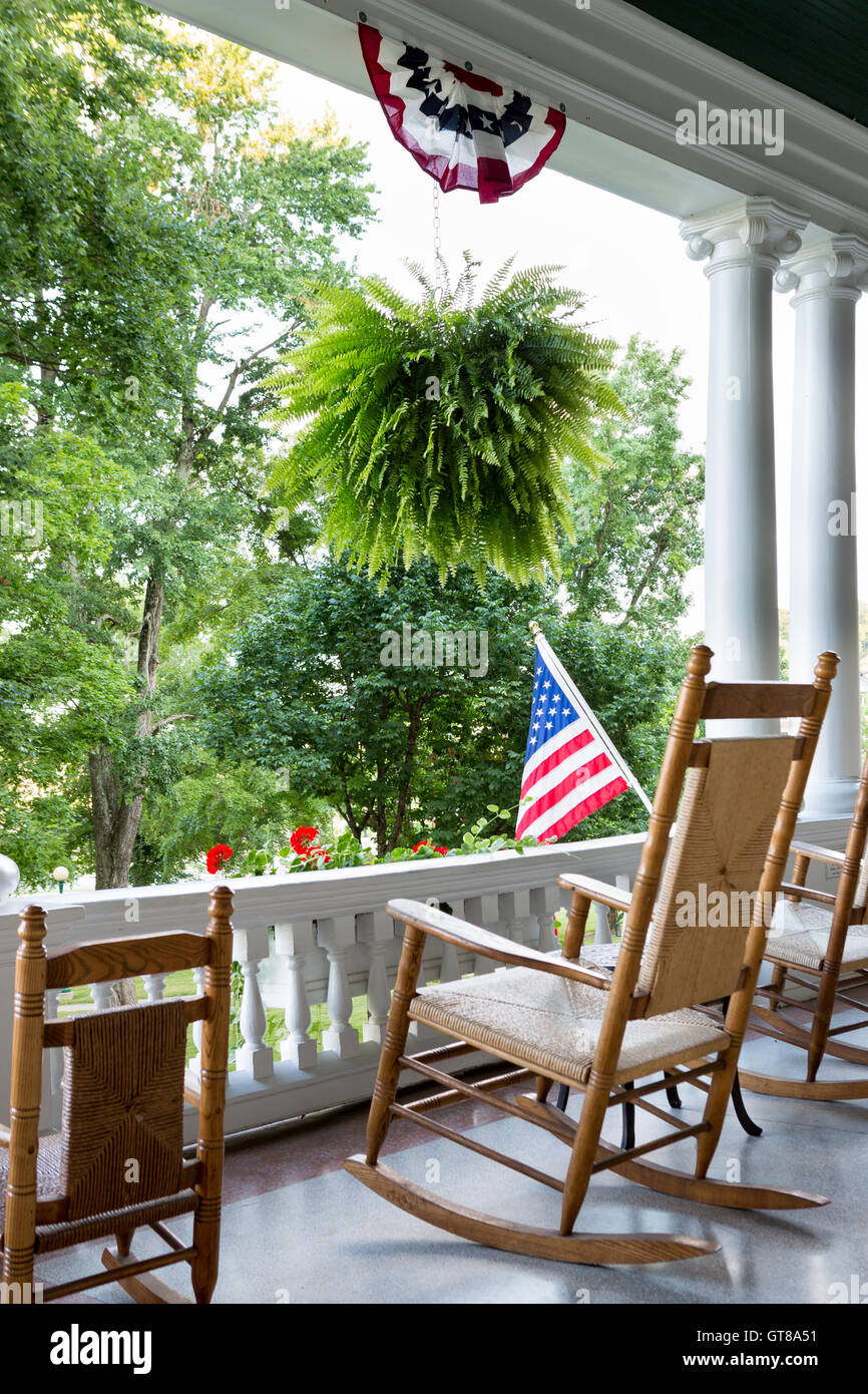 Comfortable Wooden Rocking Chair On An Outdoor Patio With An Stock
