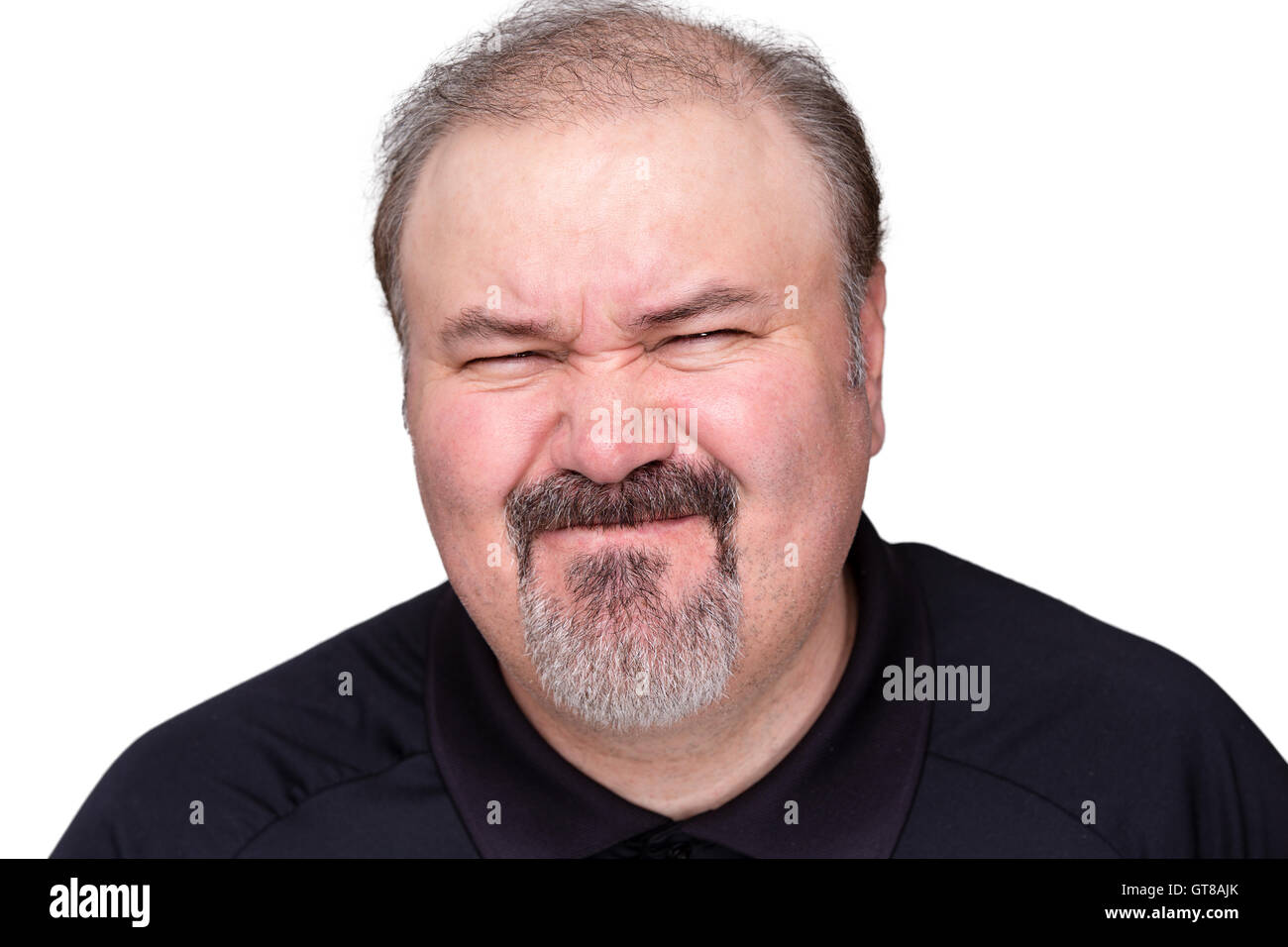 Disgusted unimpressed middle-aged man pulling a disdainful expression , head and shoulders isolated on white - Stock Image