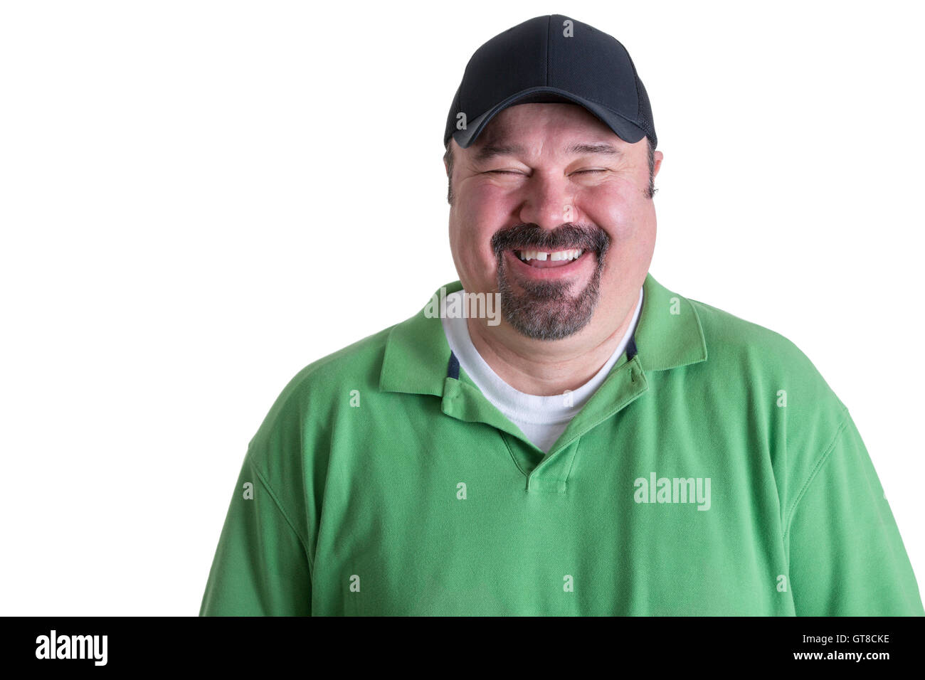 447e6467aee Portrait of Overweight Man Wearing Green Shirt and Black Baseball Cap  Laughing in front of White Background