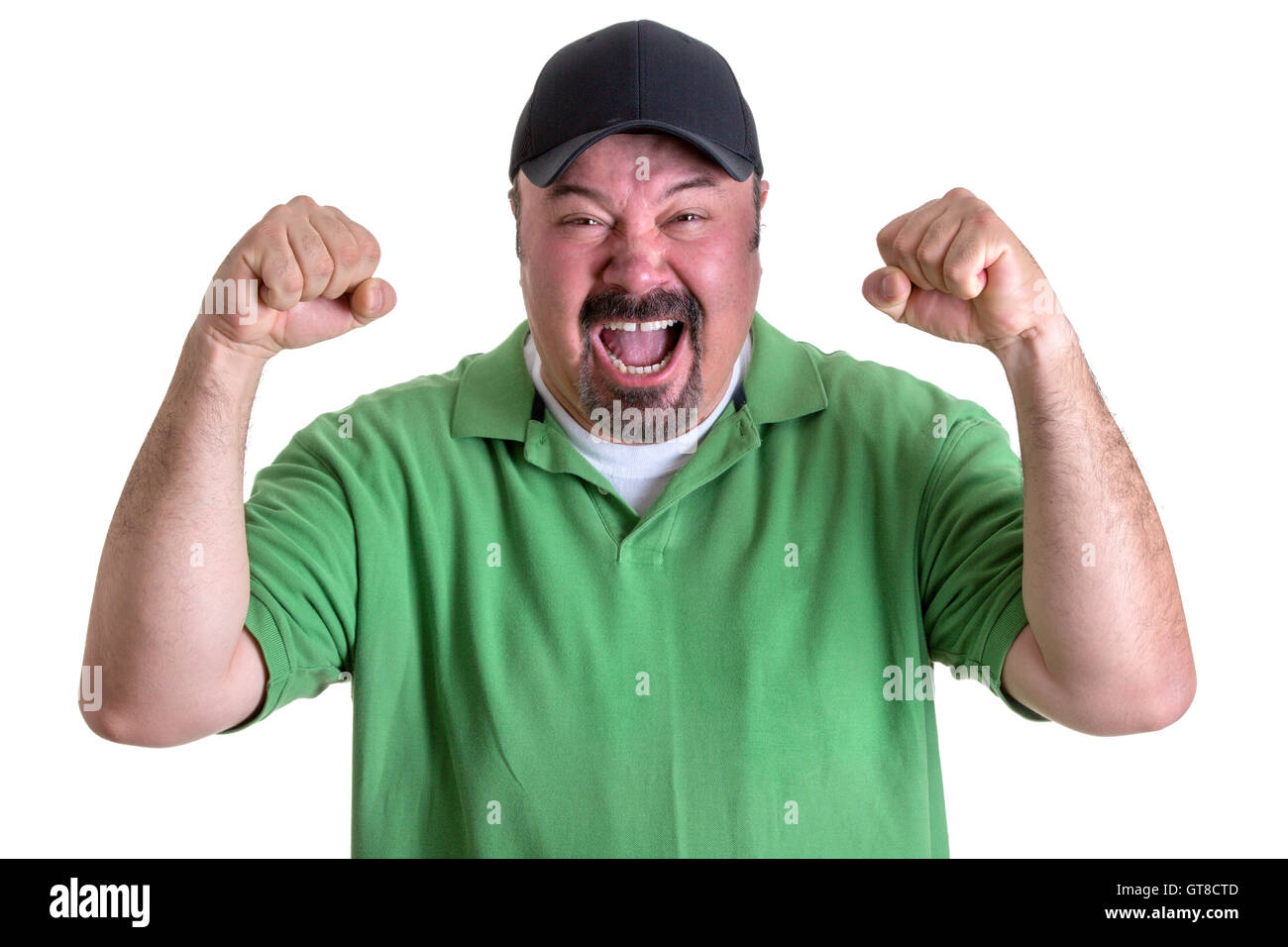 Close up Aggressive Bearded Middle Aged Man in Casual Green Polo Shirt and Black Cap, Yelling Out Loud with Fists - Stock Image