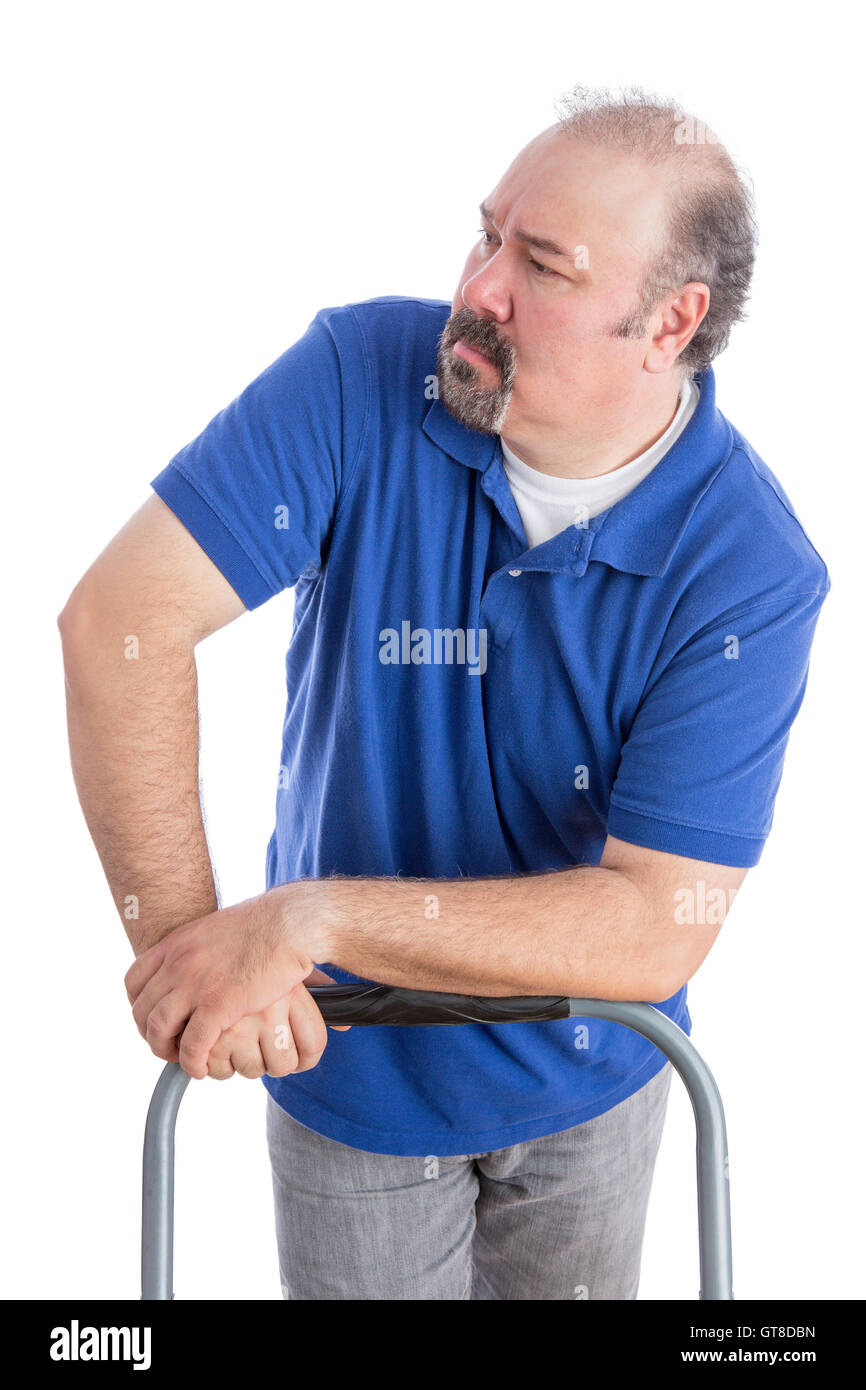 Serious Adult Man in Blue Shirt Leaning Against the Chair While Looking to the Left. Isolated on White. - Stock Image