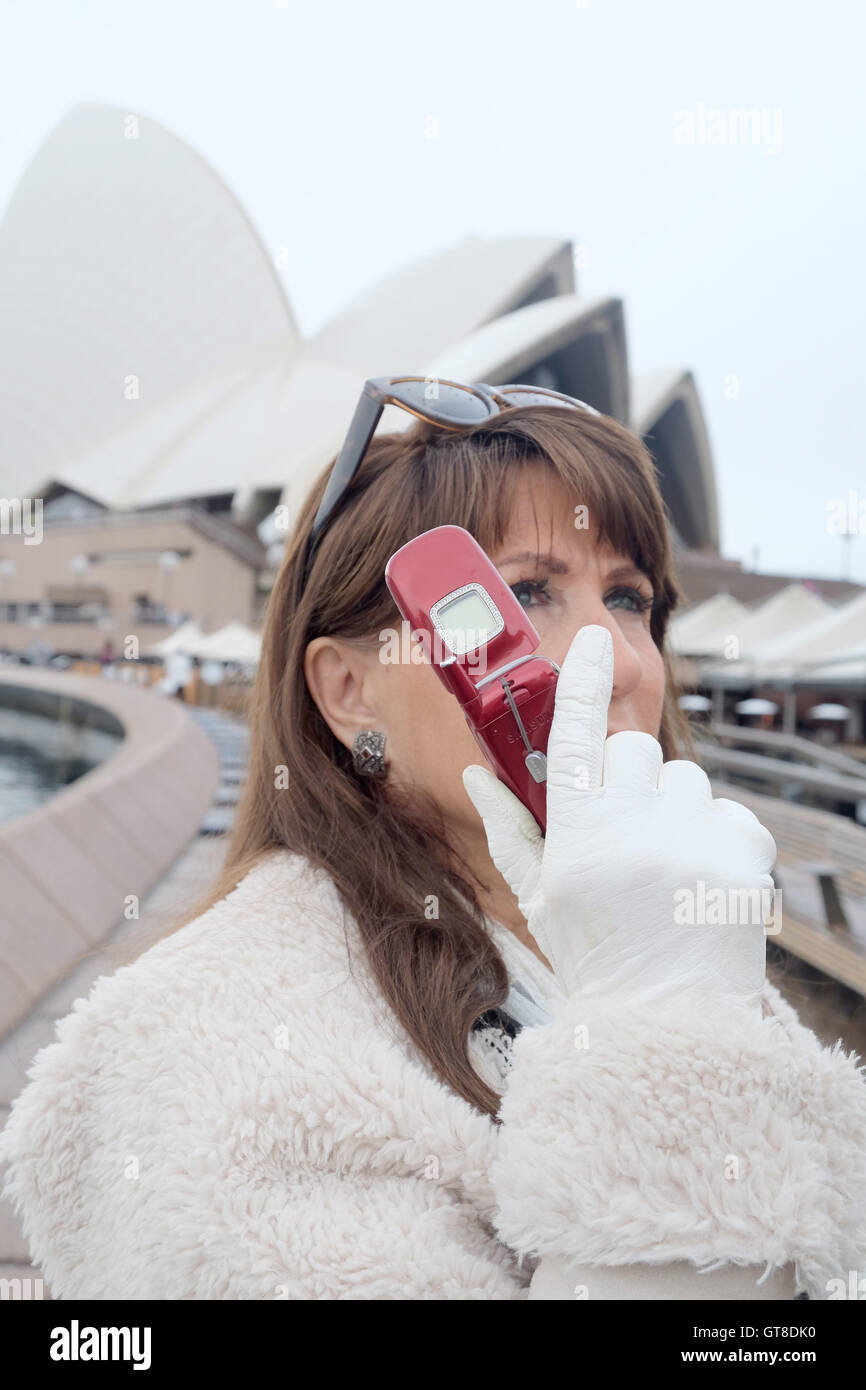 A woman uses Samsung T500 Mobile phone at Sydney Opera house Australia - Stock Image