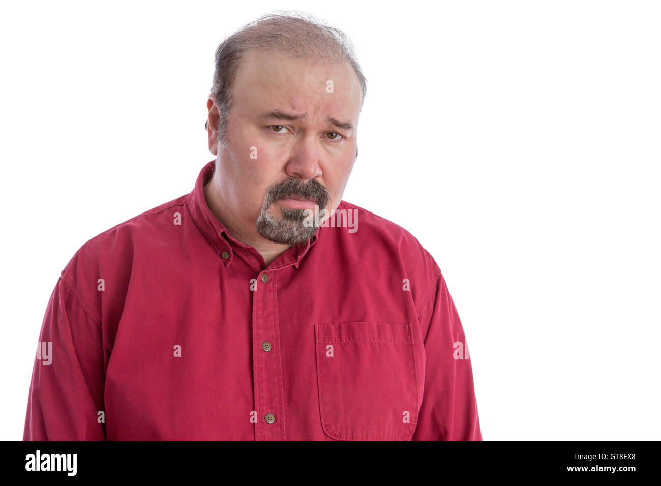 Upset and disappointed bald frowning middle-aged man looking at camera with a depressed facial expression, isolated - Stock Image