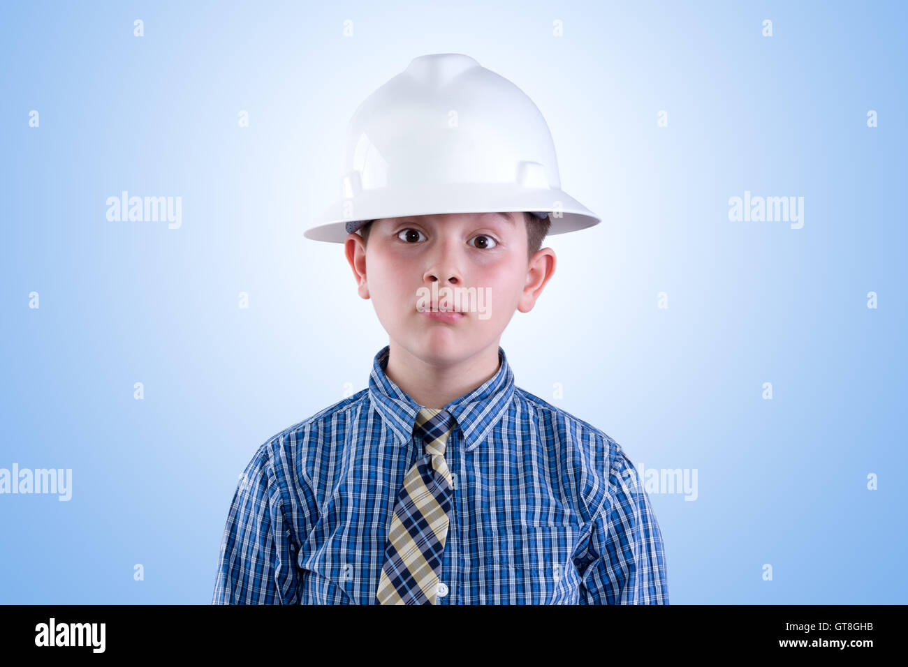 eb666583b81c9 Aspiring young tween boy dreaming of becoming an engineer in hardhat and  necktie with a whimsical expression - I am going to be