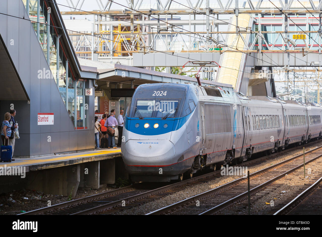 Passengers board a southbound Amtrak Acela Express train in Stamford, Connecticut. - Stock Image