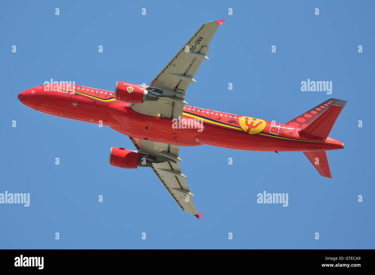 Brussels Airlines Airbus A320-214 OO-SNA in Red Devils livery departing from London Heathrow Airport, UK - Stock Image