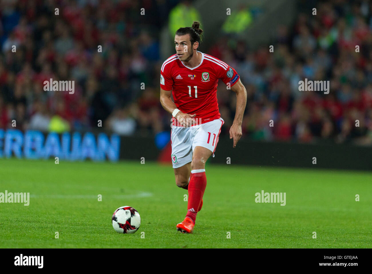 Welsh footballer Gareth Bale in action for Wales football team. - Stock Image