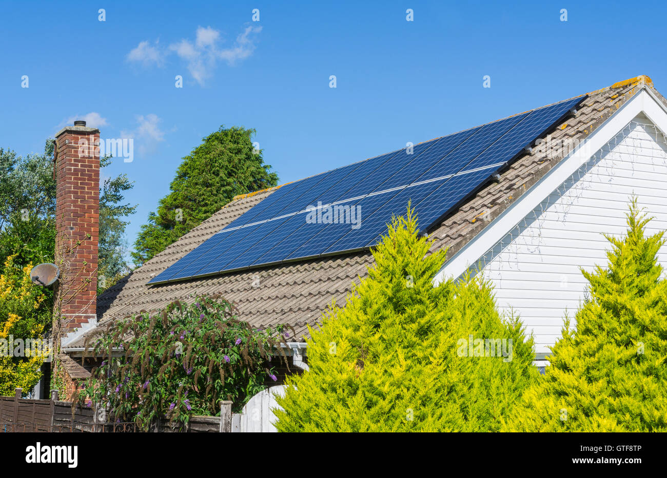 Solar panels on the roof of a bungalow in the UK. - Stock Image
