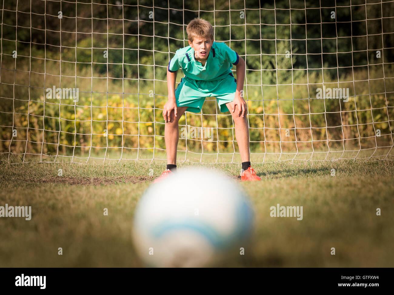 little soccer goalkeeper in goal - Stock Image