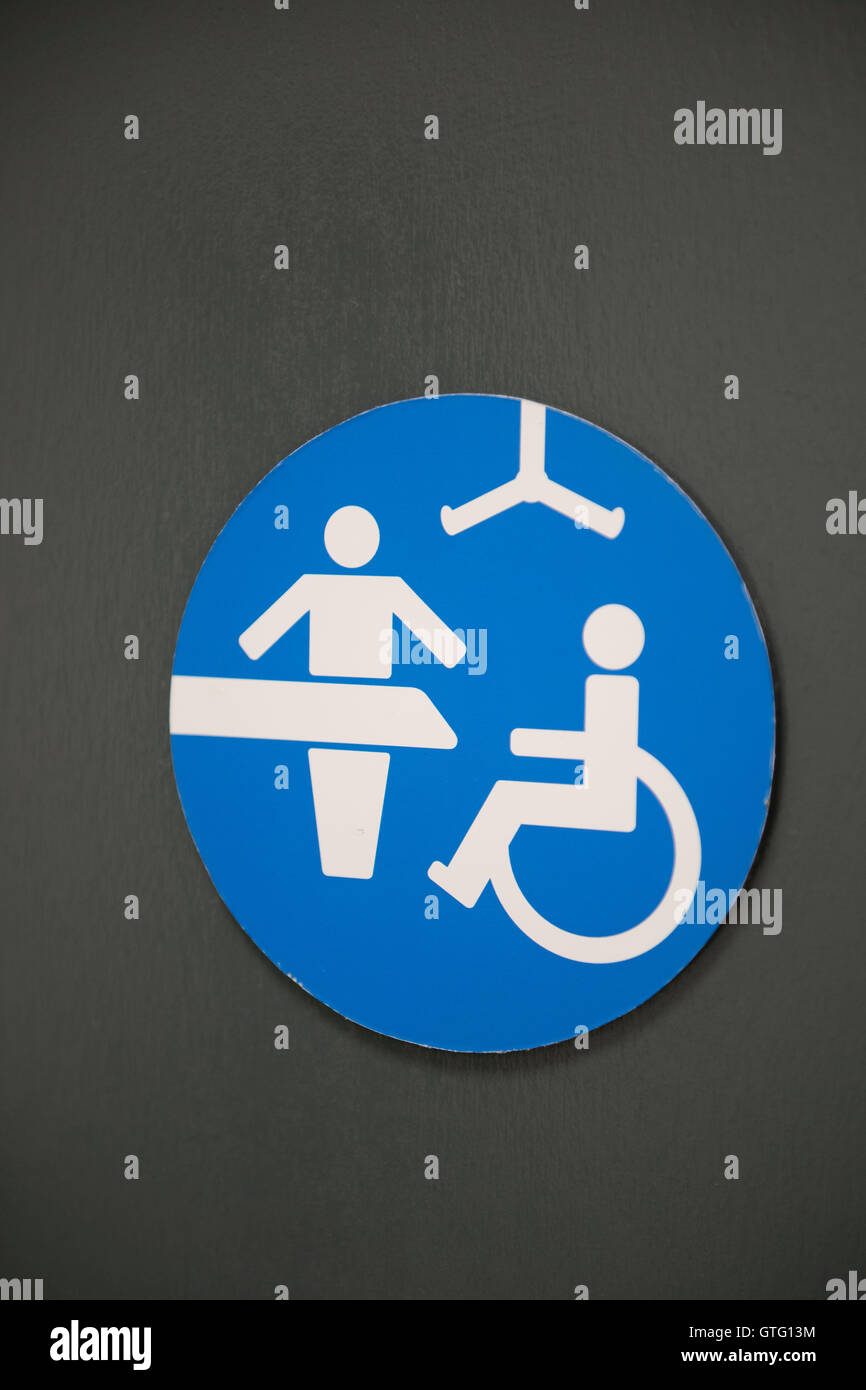Disabled toilet and baby changing facilities in a public toilet. - Stock Image