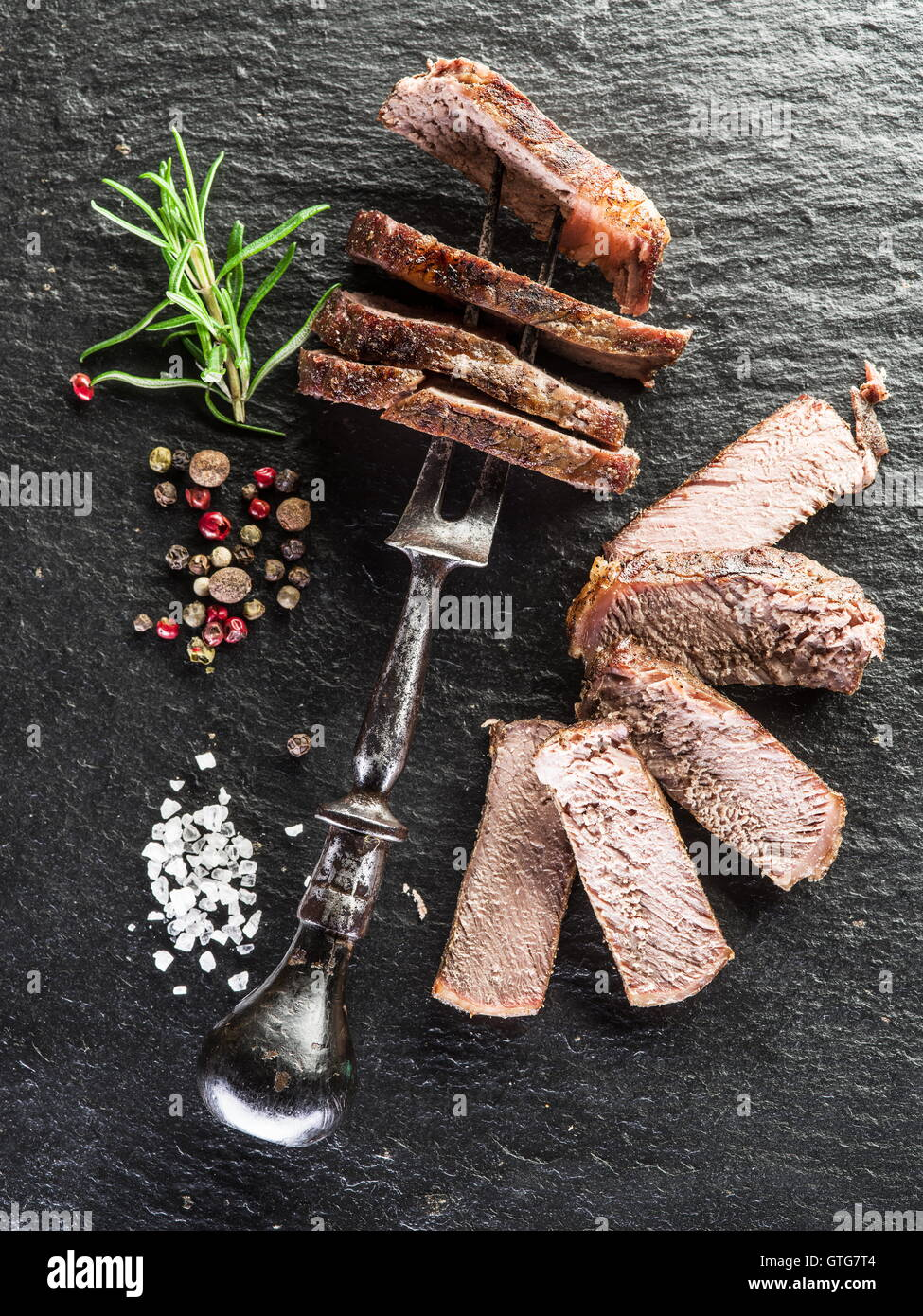 Steak Ribeye with spices on the graphite tray. Stock Photo