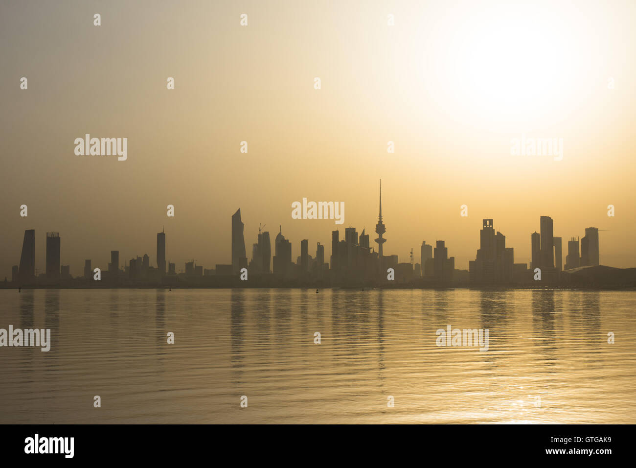 Early morning sunrise over Kuwait City on a hot August day. - Stock Image