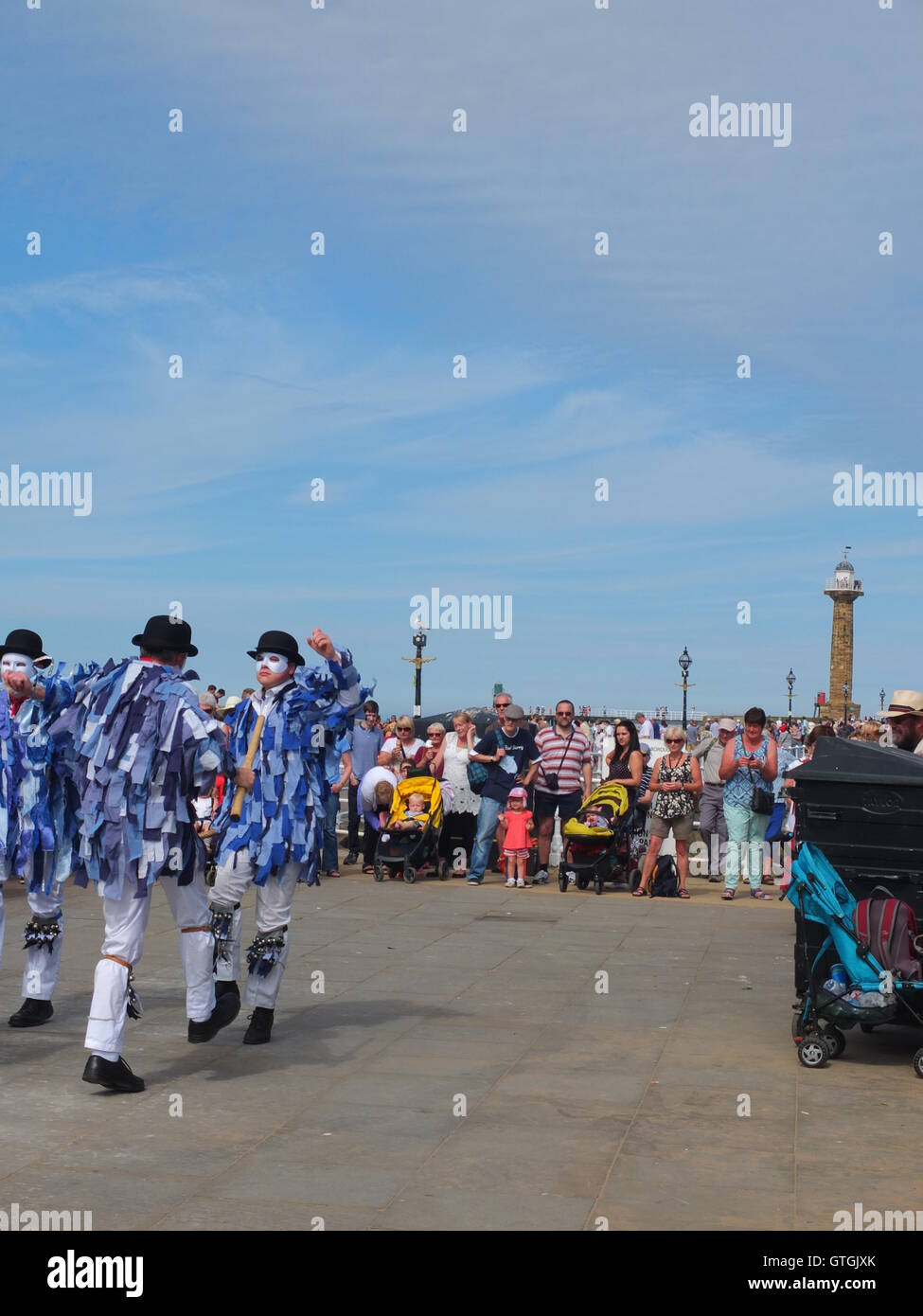 A crowd watch Hexham  Morris dancers performing on the quayside at Whitby Folk Festival 2016 Stock Photo