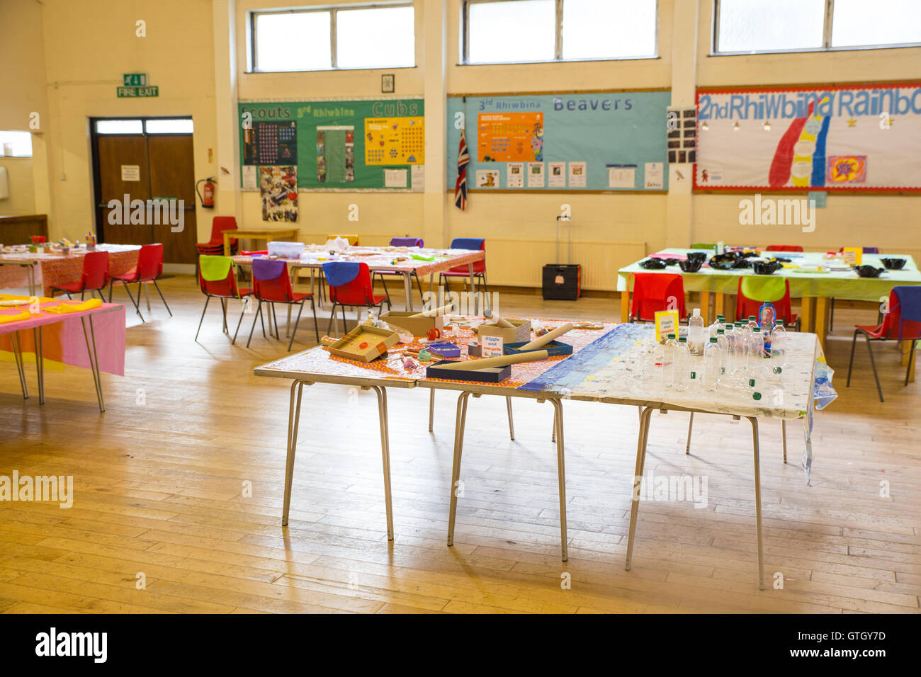 Interior of a church hall set up for activites with tables and chairs. - Stock Image