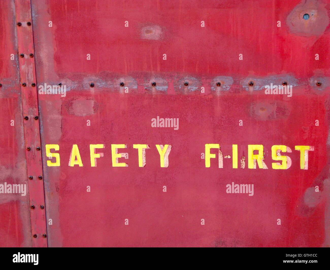 Old rail car with safety warning for workers 'Safety First' - Stock Image