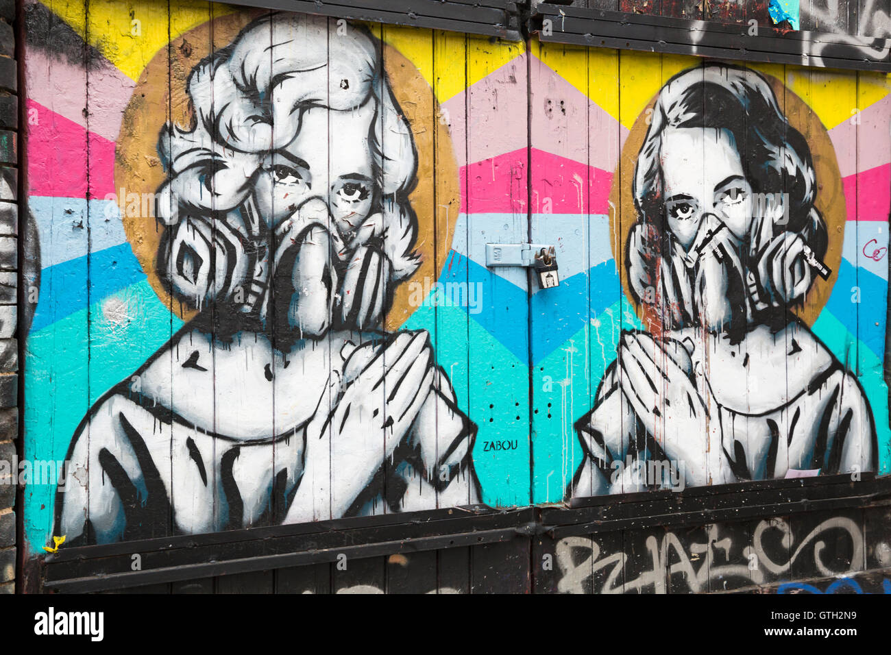 colourful mural graffiti of two women with spray cans and ...Graffiti Spray Can With Face