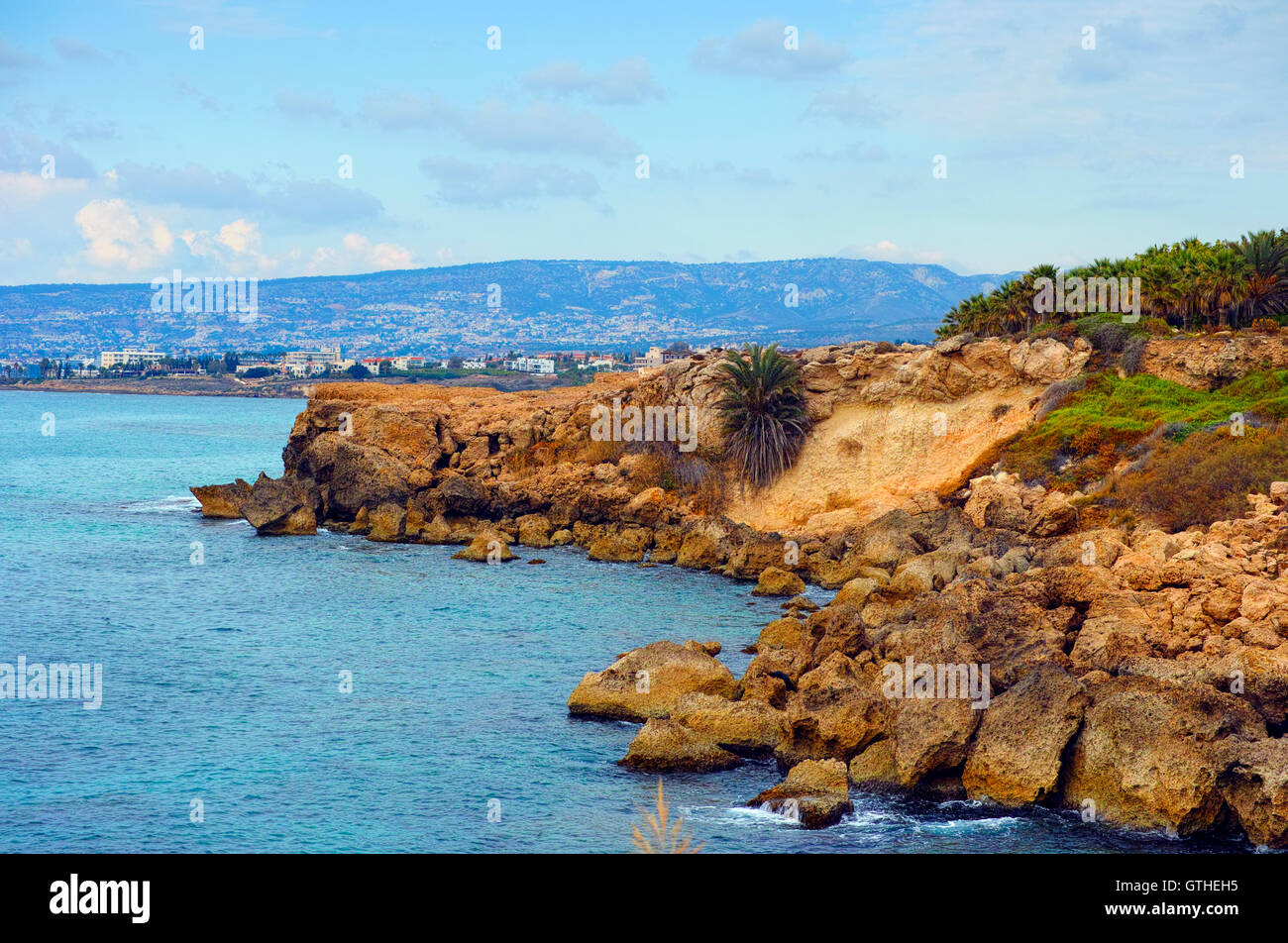 Seacoast with rocks and mountains view. Mediterranean Sea, Cyprus, Paphos region. - Stock Image