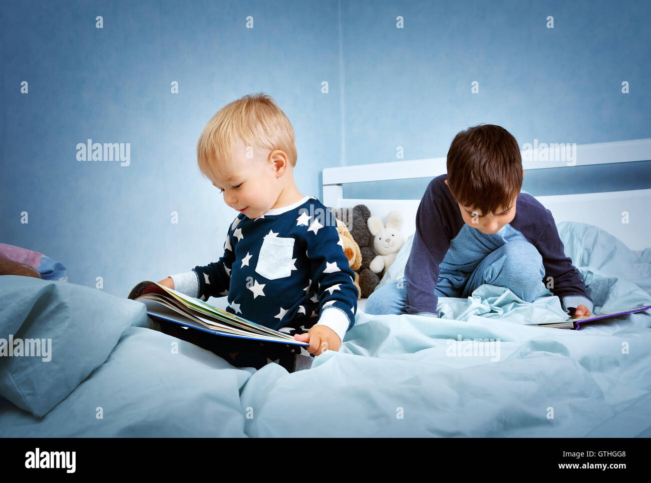 children jumping on the bed Stock Photo