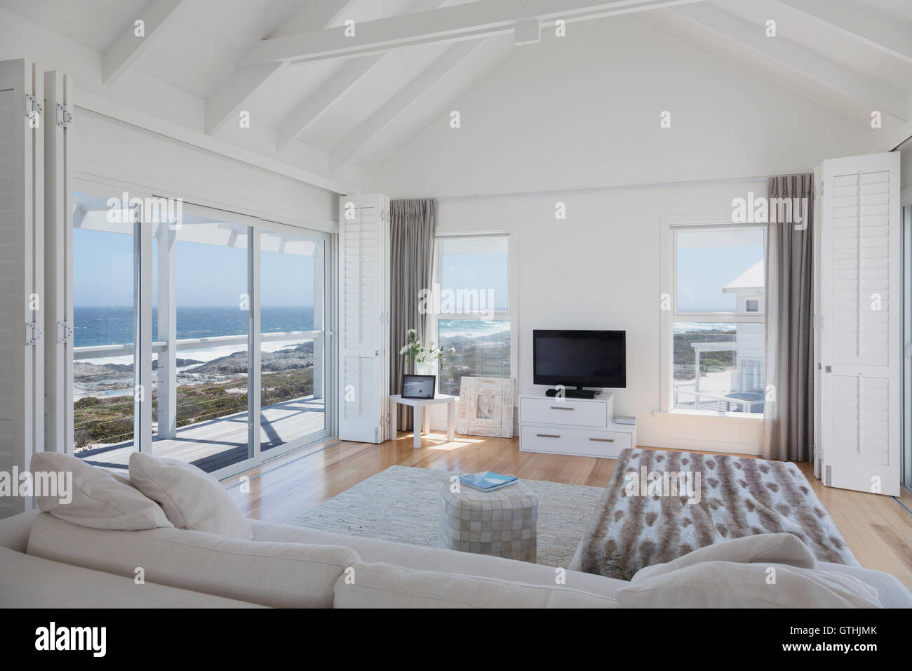 Wood beam vaulted ceiling living room in home showcase beach house ...