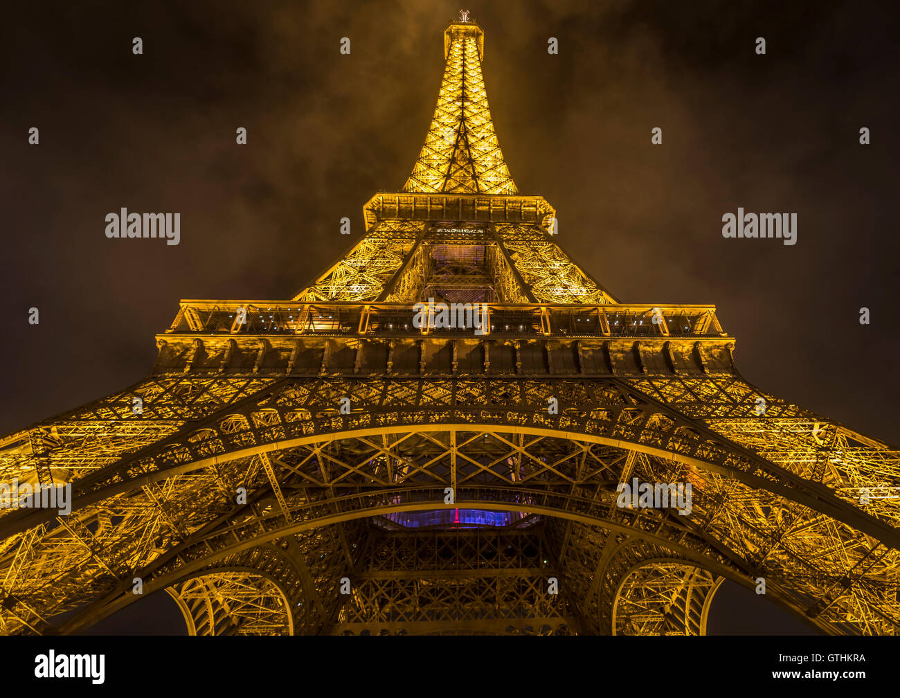 Bottom up night view with the Eiffel Tower - Stock Image