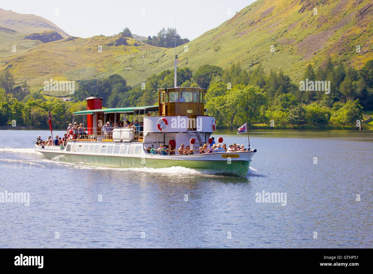 Tourists enjoying a cruise aboard an Ullswater Steamer. Howtown Wyke bay, Ullswater, Penrith, The Lake District Stock Photo