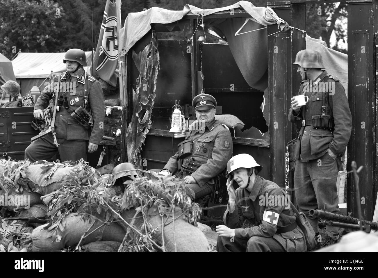 German Army in a bombed café during the war in France - Stock Image