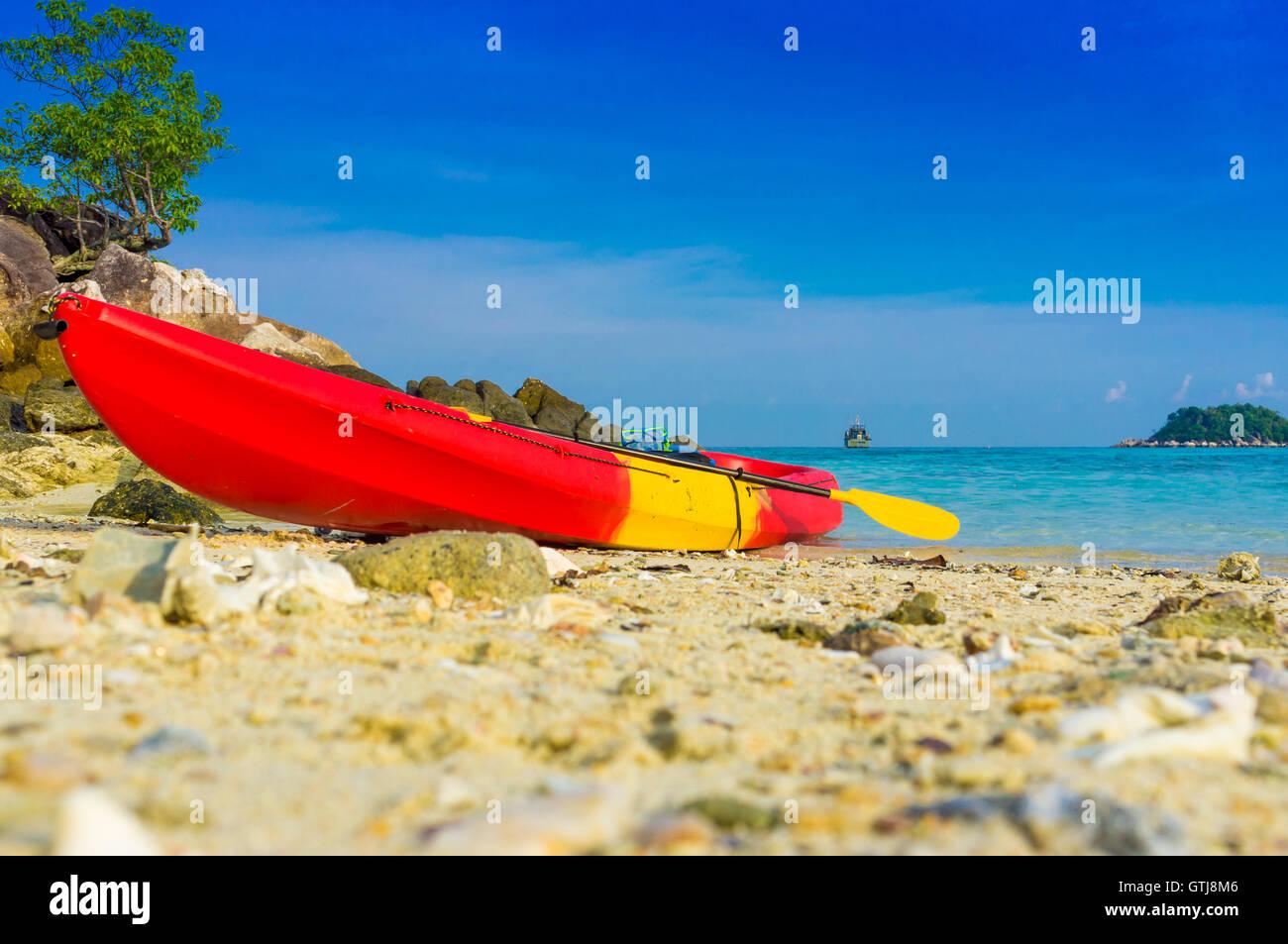 Red yellow kayaks on the tropical beach, Lipe island, Thailand - Stock Image