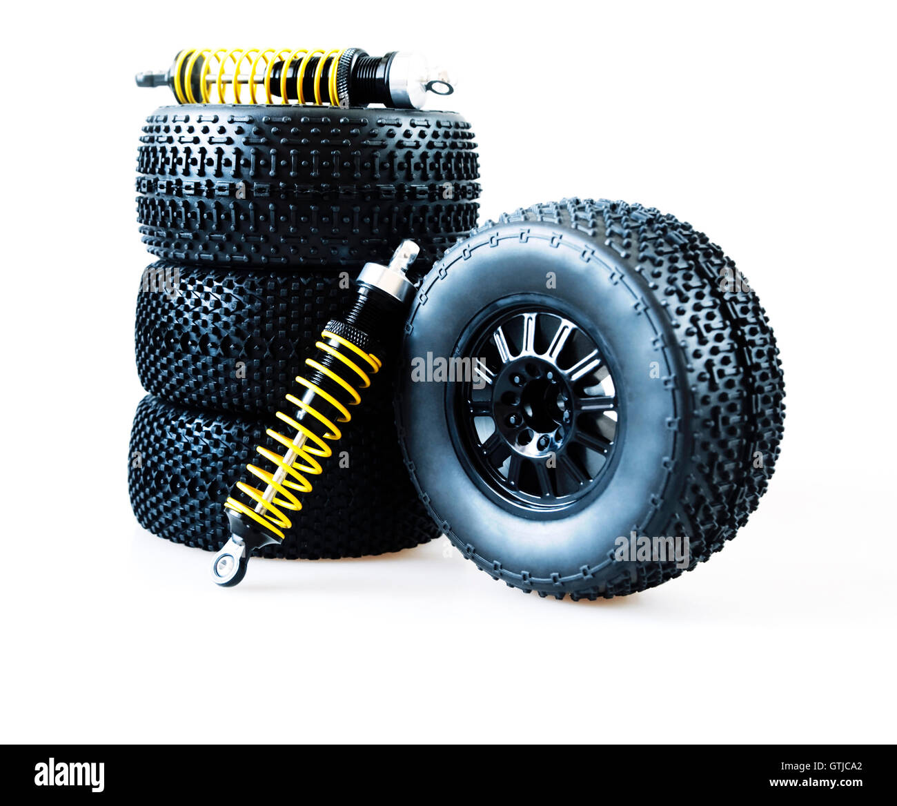 : wheels and shock absorbers on a white background - Stock Image