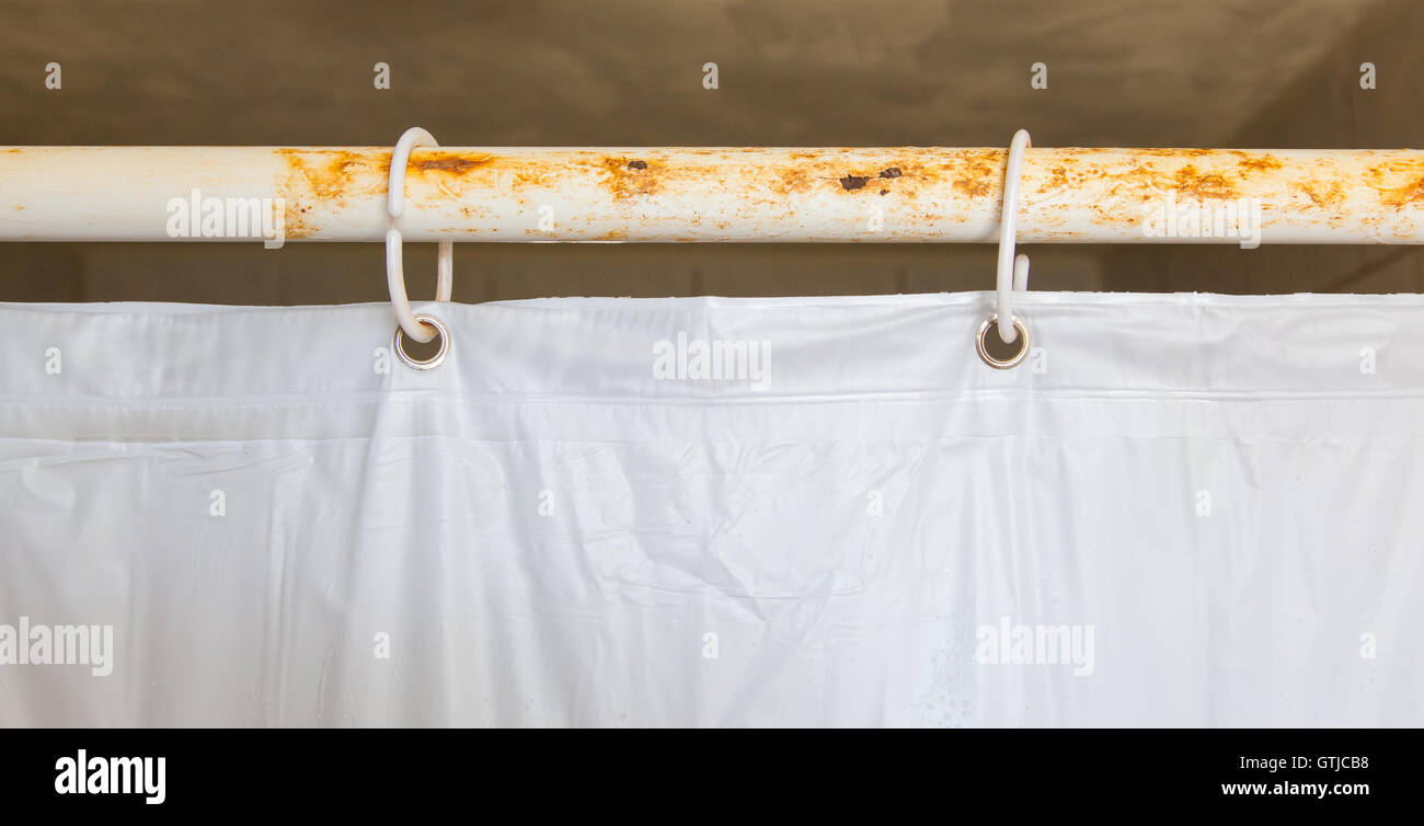 White shower curtain in the bathroom - Stock Image