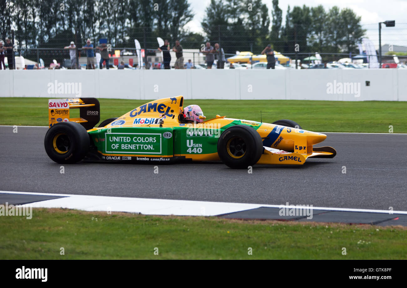A 1992 Benetton B192 Formula One Car, formerly driven by Michael Schumacher, being demonstrated at the 2016 Silverstone - Stock Image