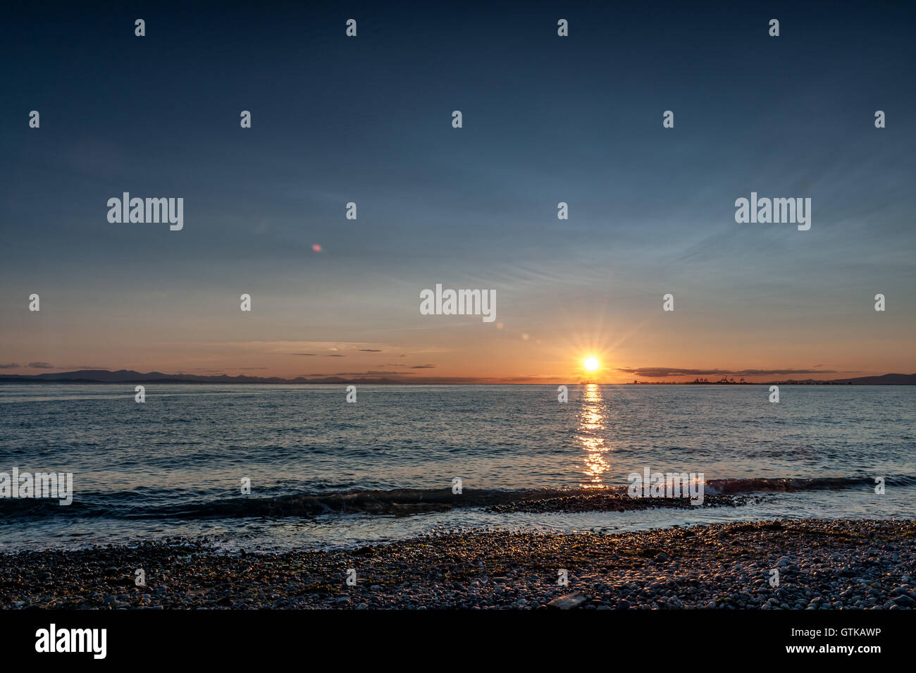 Point Roberts sunset  at moonlight over the beach with cranes in background, Washington State, SA - Stock Image
