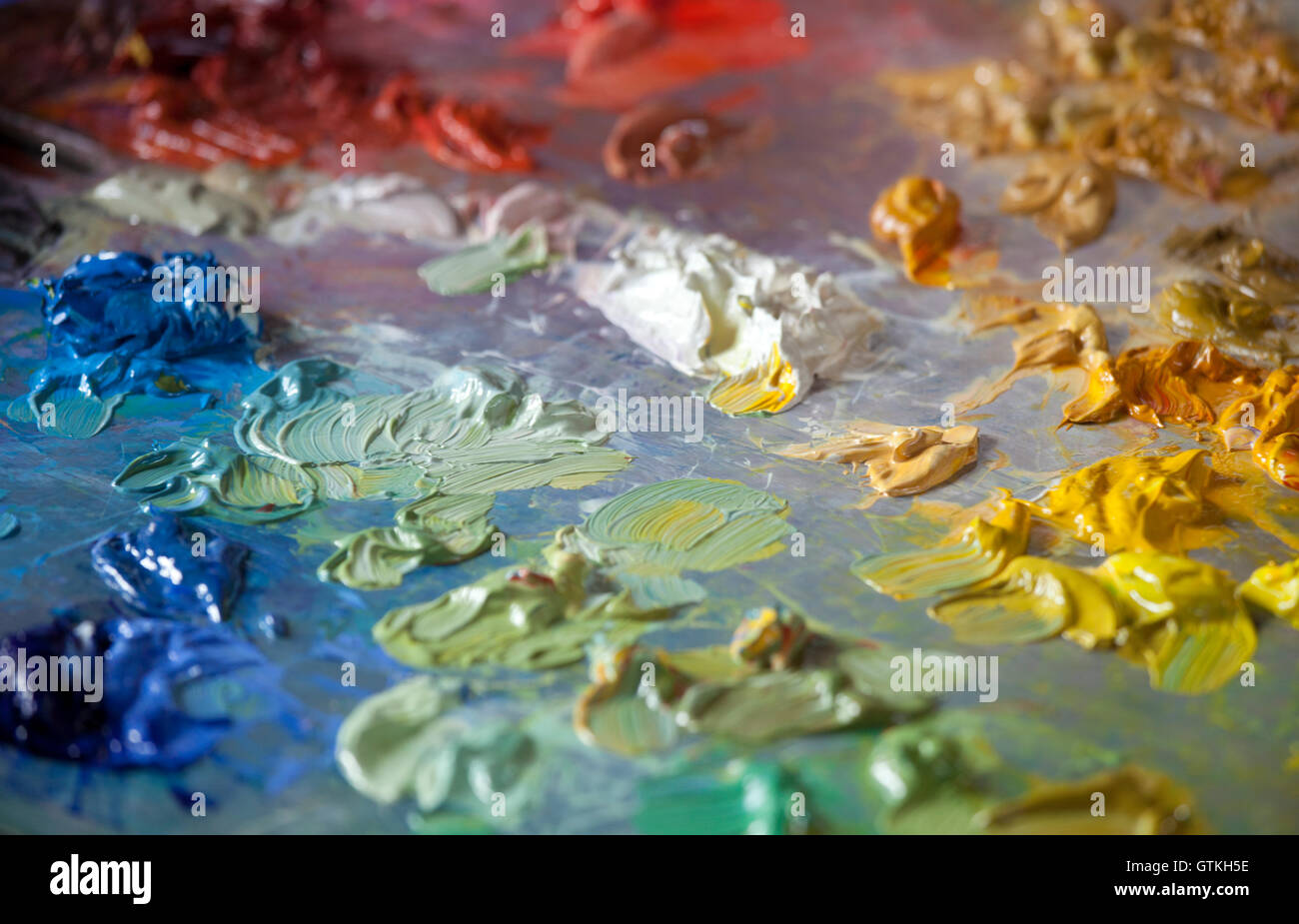 Close-up of oil paint on a painter's palette - Stock Image