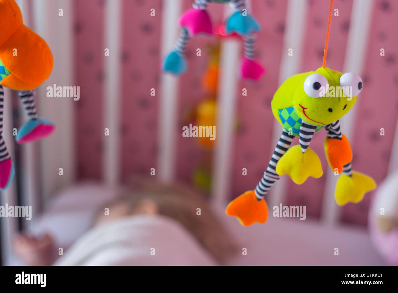 Baby mobile above the cradle; baby sleeping Stock Photo