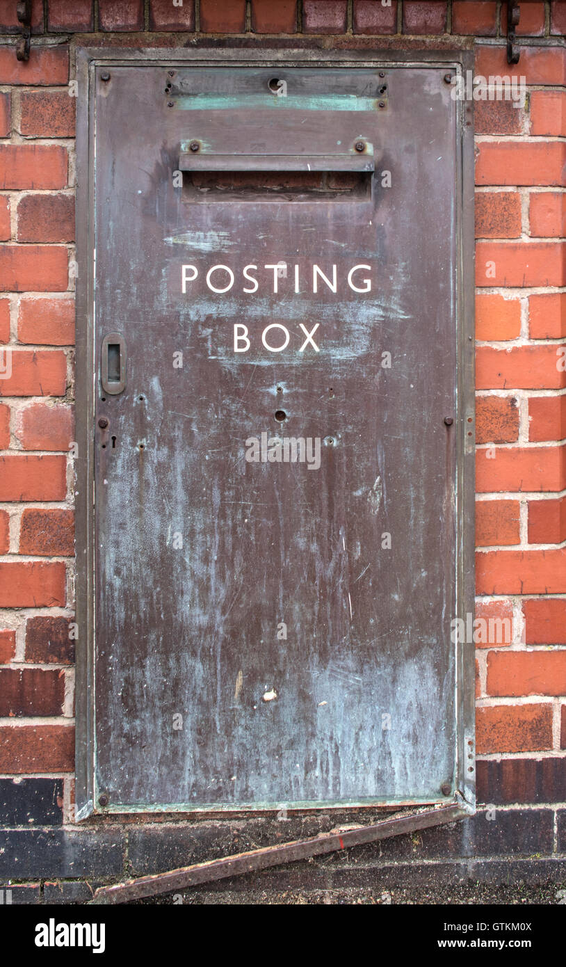An old post box on a redundant post office, a common sight these days - Stock Image