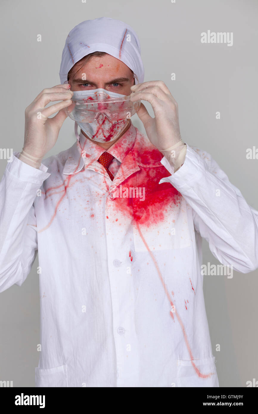 Doctor in a bloody robe - Stock Image