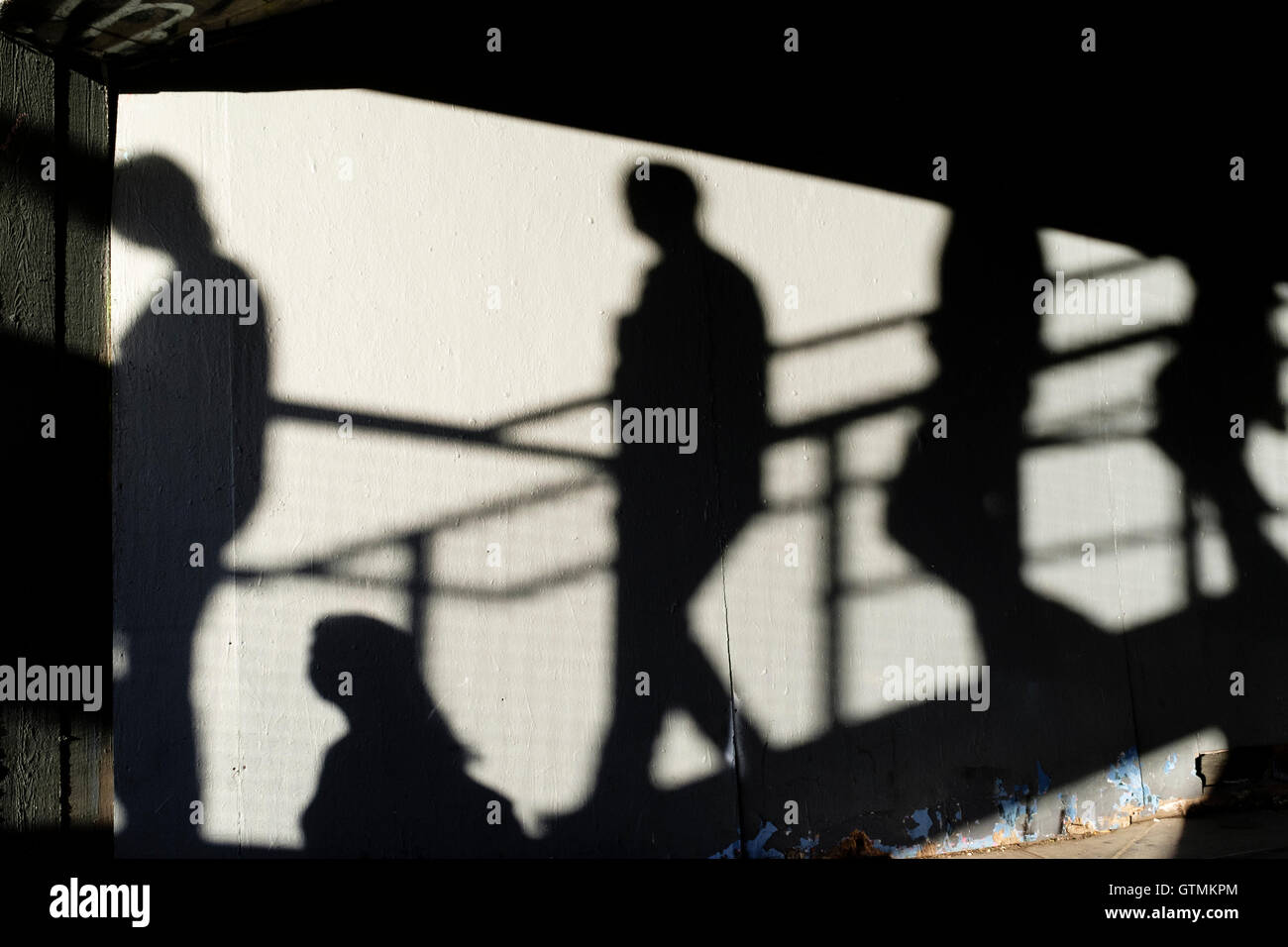 Shadows of figures on stairs - Stock Image