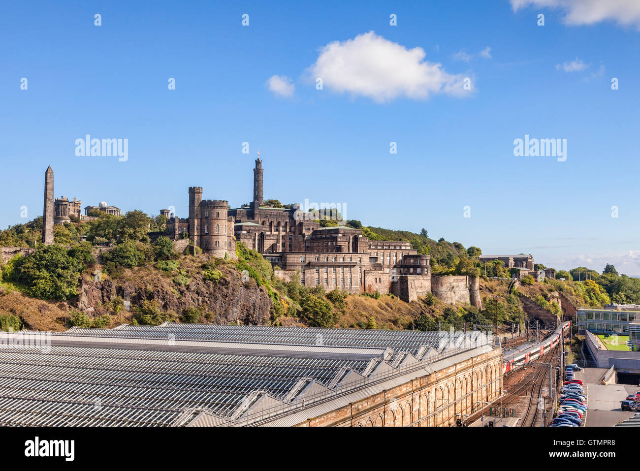 Calton Hill and Waverley Street Station, Edinburgh, Scotland, UK - Stock Image