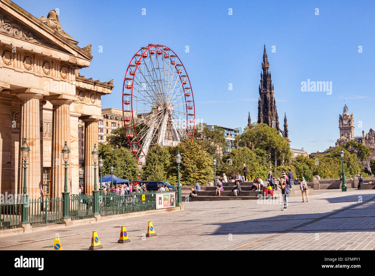 Edinburgh skyline, with the Scottish National Gallery, the Festival Wheel, the Scott Monument, and the clock tower - Stock Image