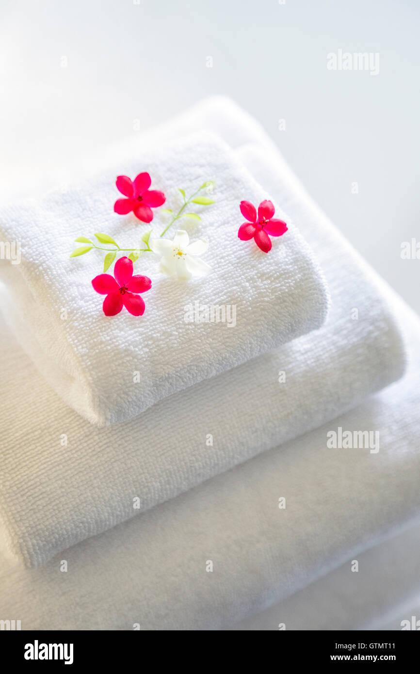 Folded white towels - Stock Image