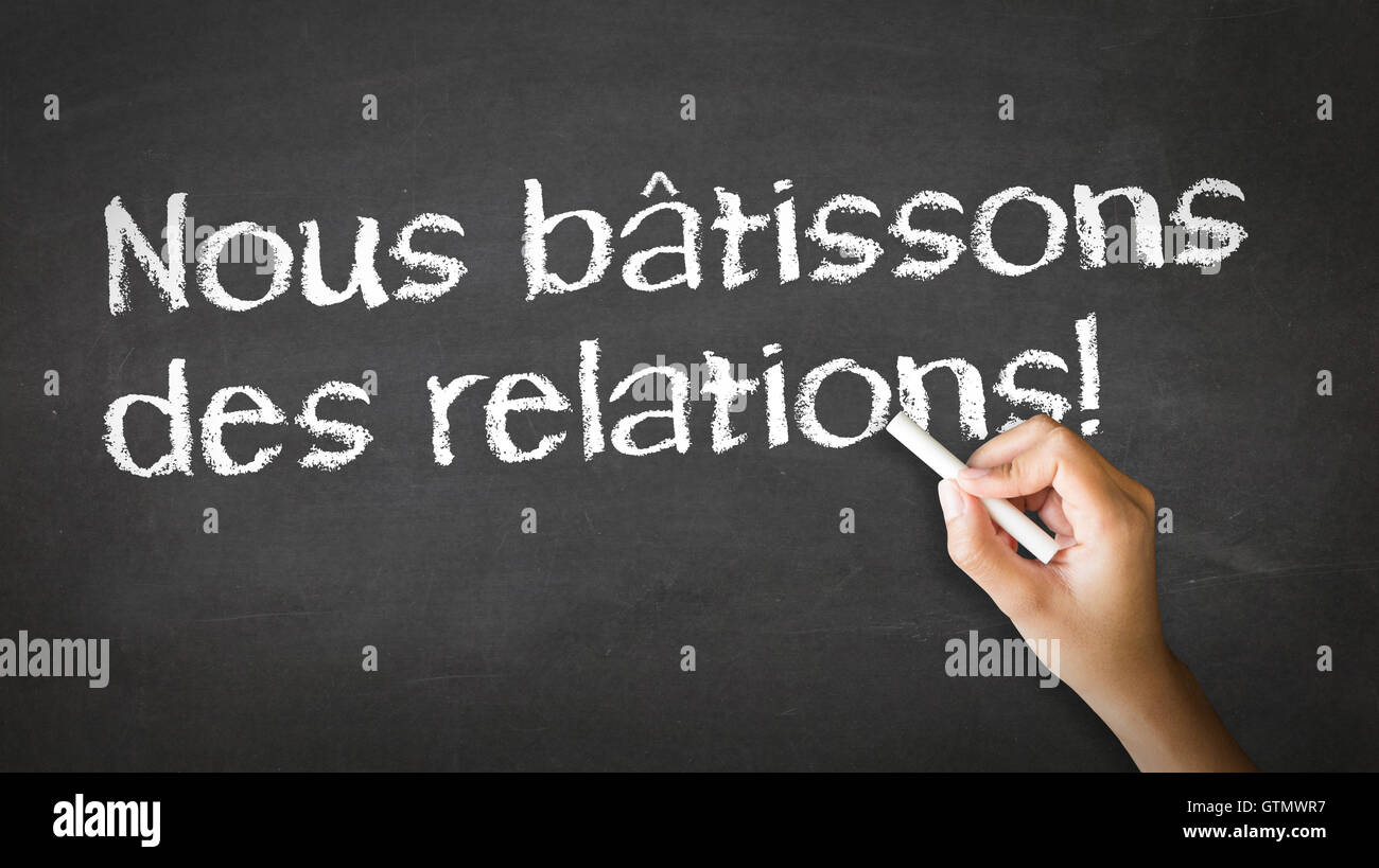 We Build Relationships (In French) - Stock Image
