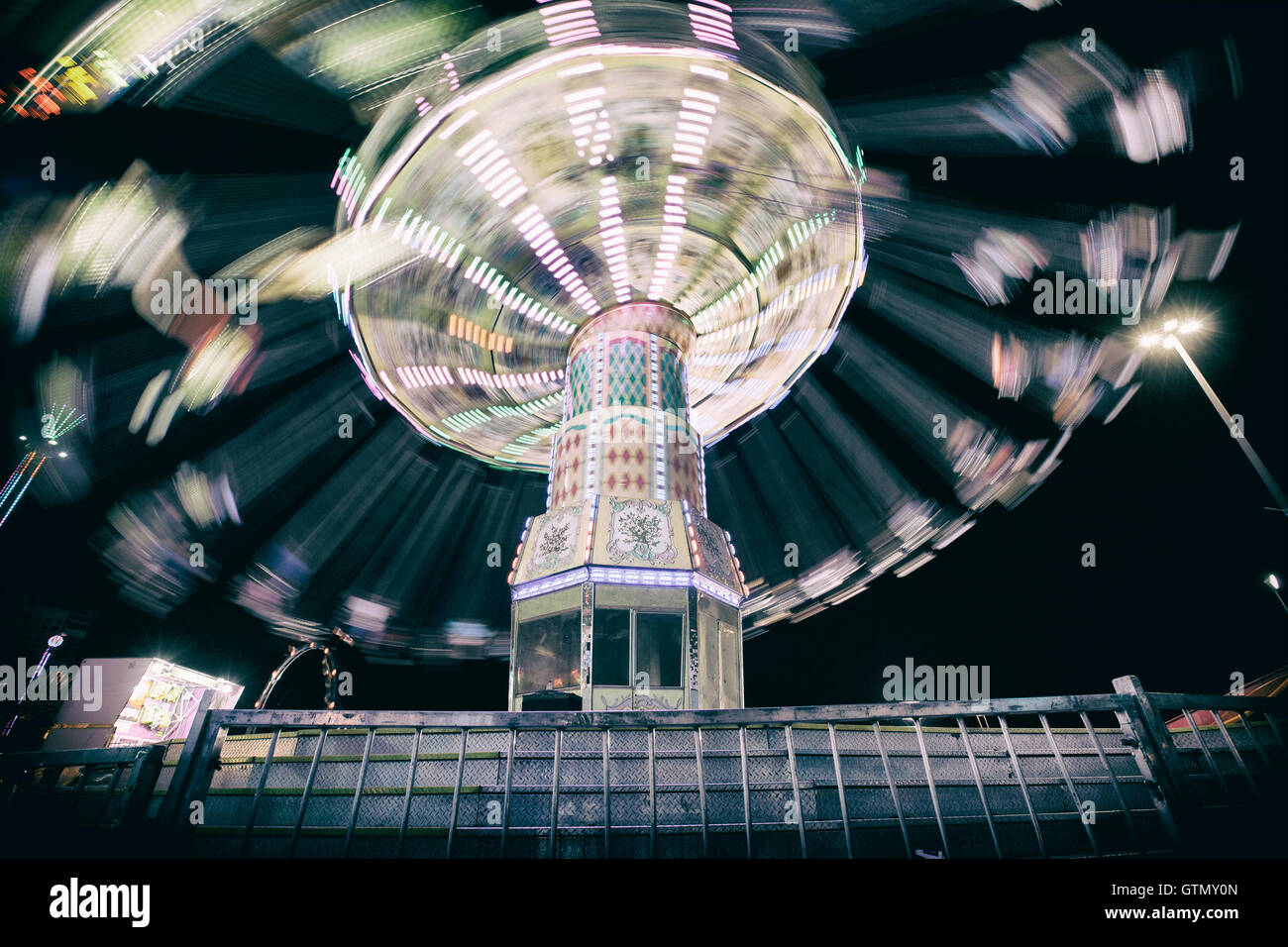swing ride at carnival fair with blur motion effect - Stock Image