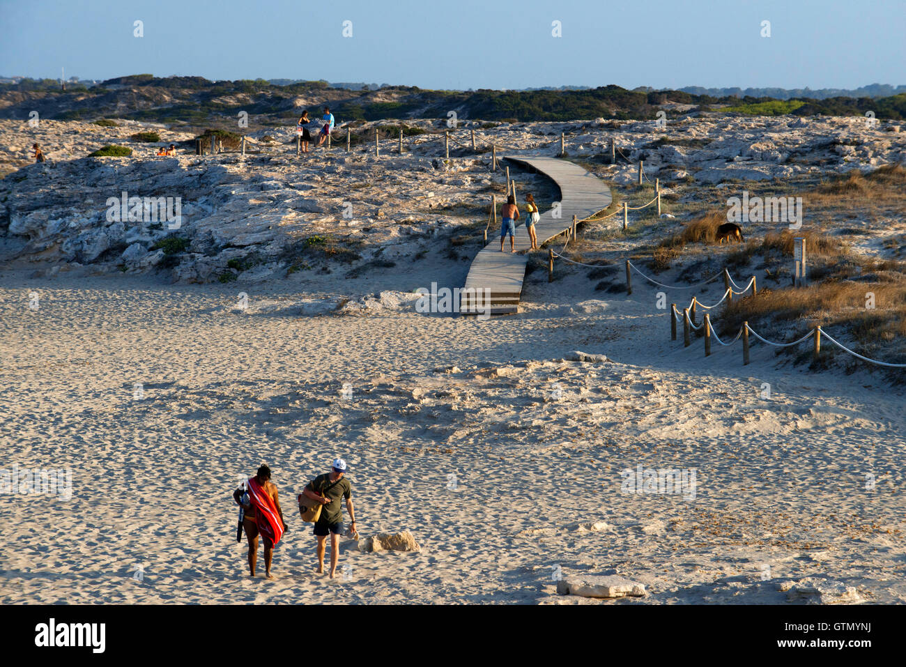 Sa Roqueta Beach and Ses Illetes Beach, Balearic Islands, Formentera, Spain. Couples walking in the sand. - Stock Image