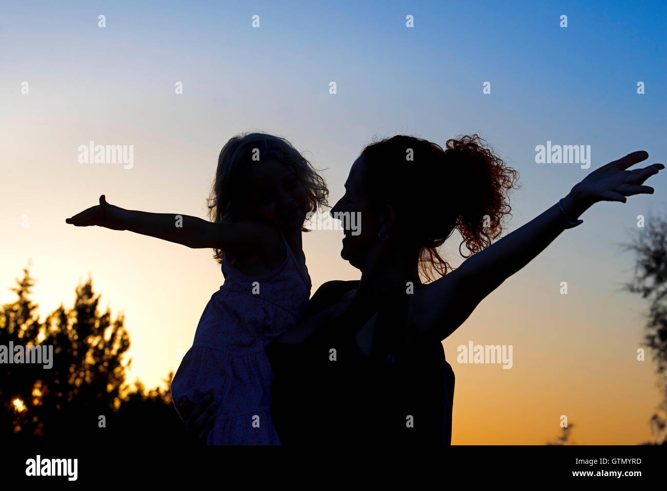 Backlighting. Mother with a child. Sunset. Pudent Lake. Formentera. Balearic Islands, Spain, Europe. Stock Photo
