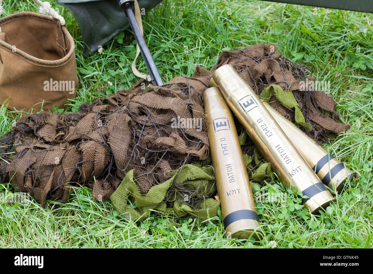 Mortar shell casings on camouflage netting - Stock Image