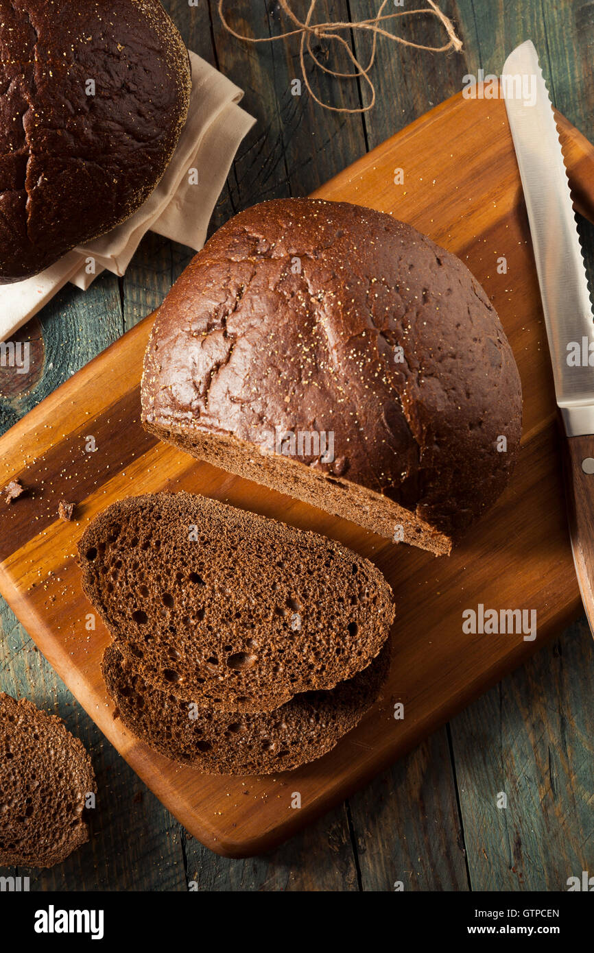 Homemade Organic Pumpernickel Rye Bread Cut into Slices - Stock Image