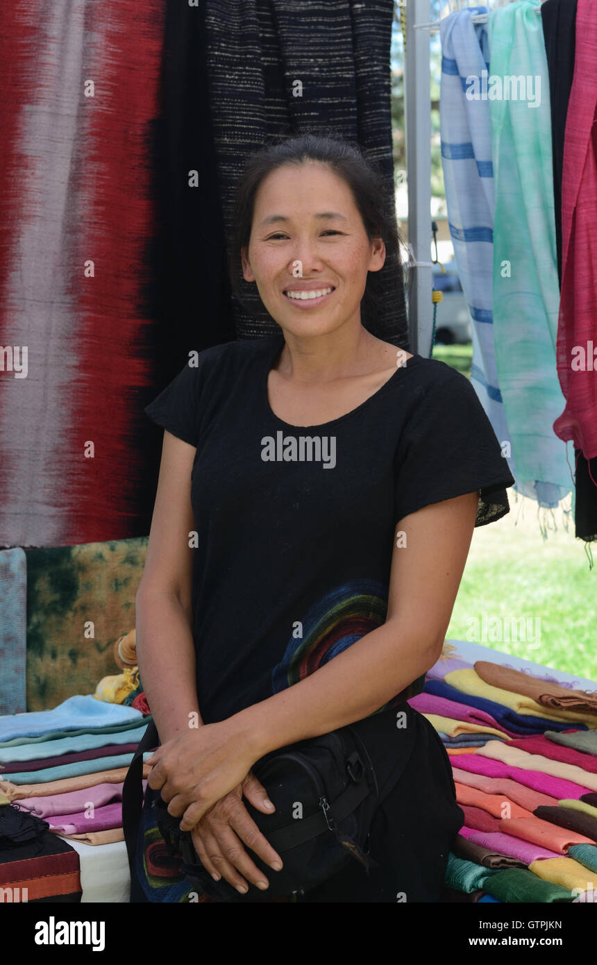 Aay Bravin sells her fabric creations at the Boulder Home Town Festival - Stock Image