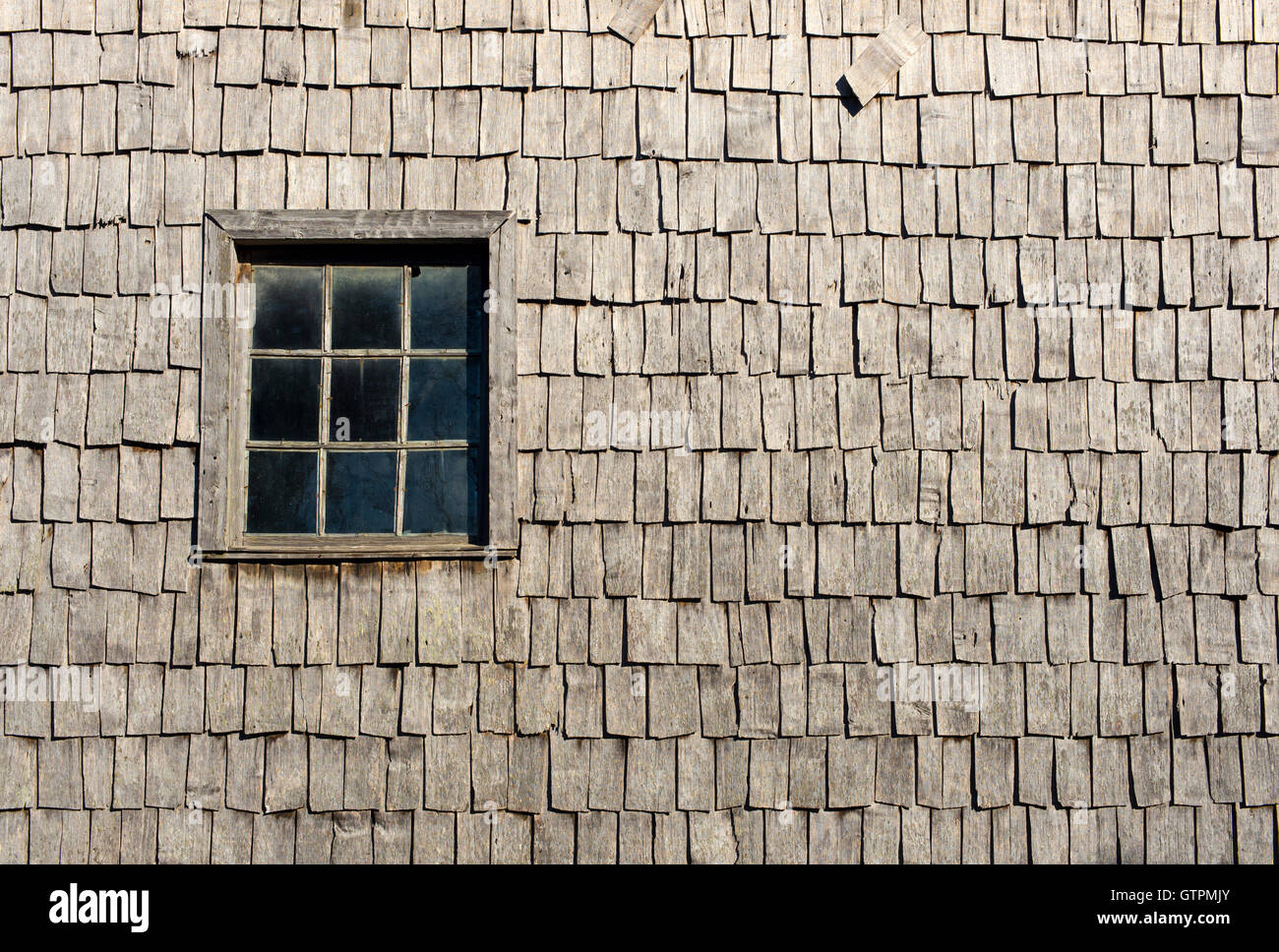 Window, old window. Chiloe, Chile. Madera de alerce, vestigio. - Stock Image