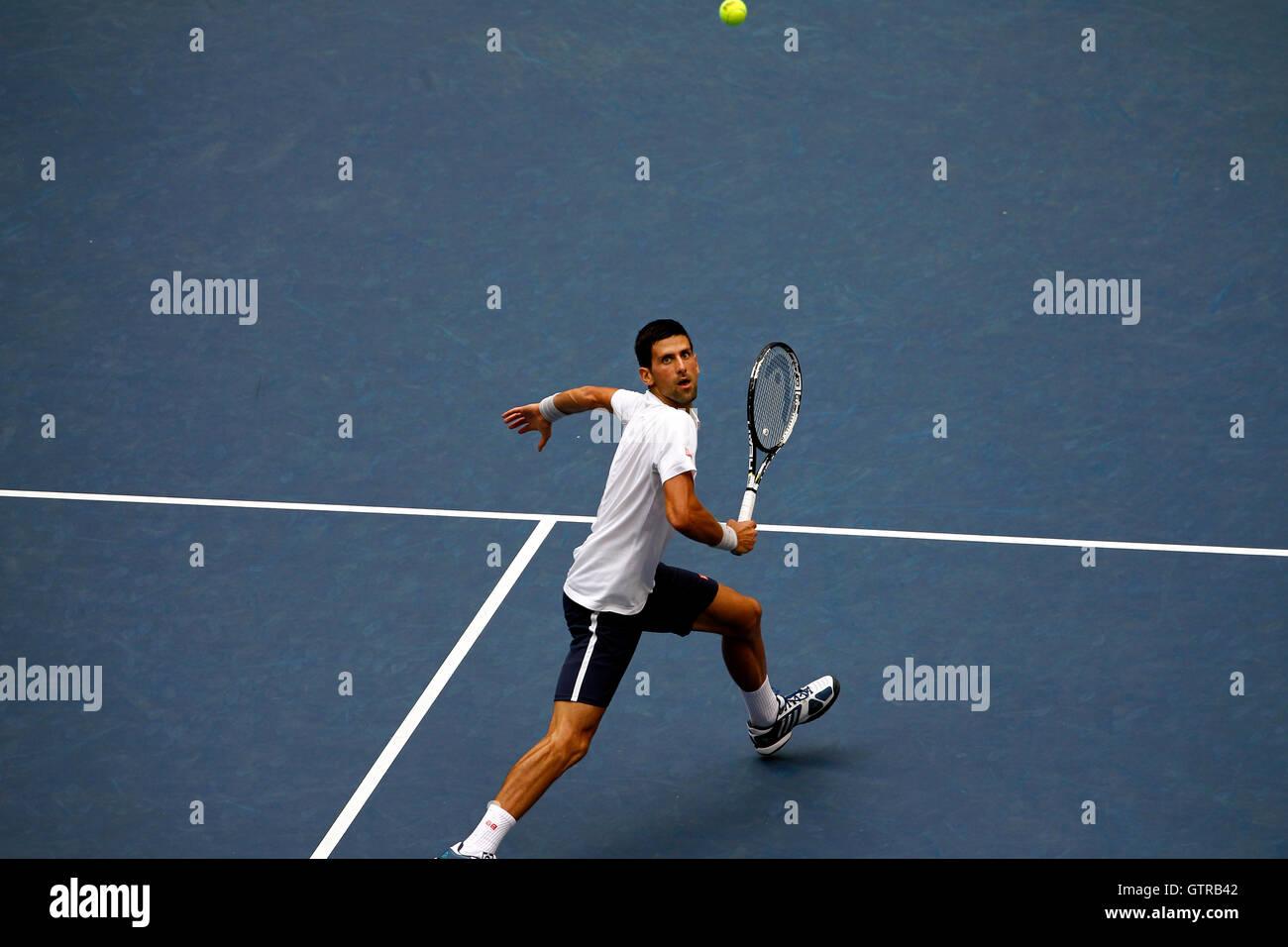 New York, United States. 09th Sep, 2016. Novak Djokovic tracks a lob during his semi final match against Gael Monfils - Stock Image