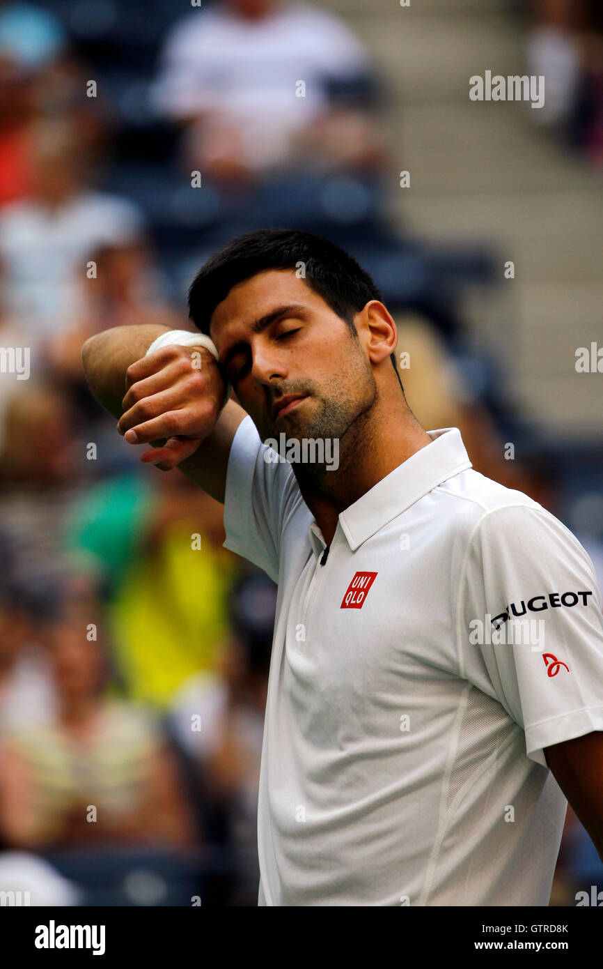 New York, United States. 09th Sep, 2016. Novak Djokovic wipes his brow during his semi final match against Gael - Stock Image